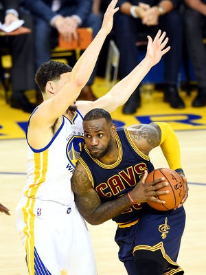Cleveland Cavaliers forward LeBron James (23) drives to the basket against Golden State Warriors guard Klay Thompson (11) during the third quarter in Game 1 of the NBA Finals.