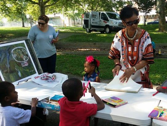 Eunice La Fate leads an art project in Price's Run