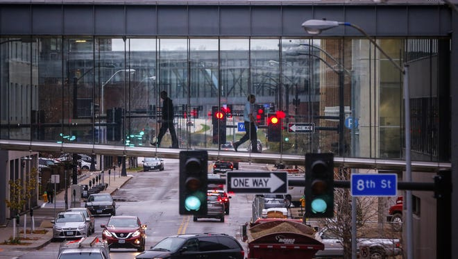 Pedestrians cross Walnut street in the Des Moines skywalk. The indoor walkways are nice on cold days, but they can be confusing. Download the skywalk app to find your best route.