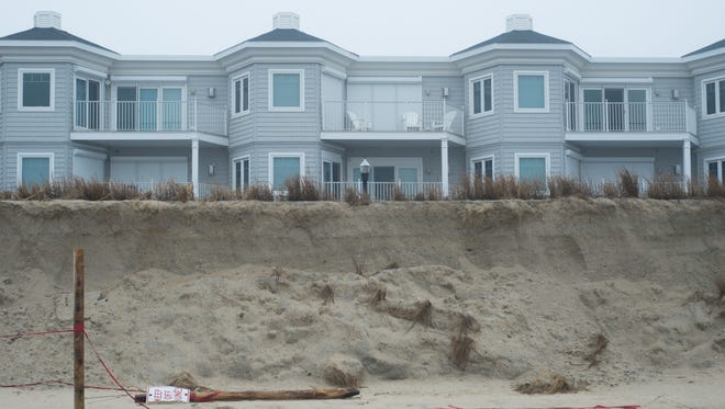 A steep cliff in an eroded dune in Bethany Beach.
