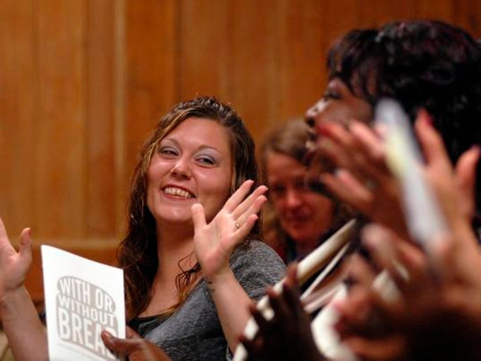 Mary McKune, left, reacts after hearing a humorous