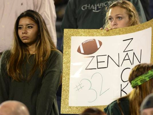 Disappointed fans watch as time runs out on the Viera Hawks Friday in the state championship game.