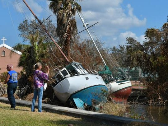 Boats smashed into the shore just south of St. Mark's Episcopal Church in Cocoa Village. Damage to boats, docks, trees, boat houses, and more along the Indian River in Cocoa and Rockledge on the Sunday after Hurricane Irma first hit the Space Coast.