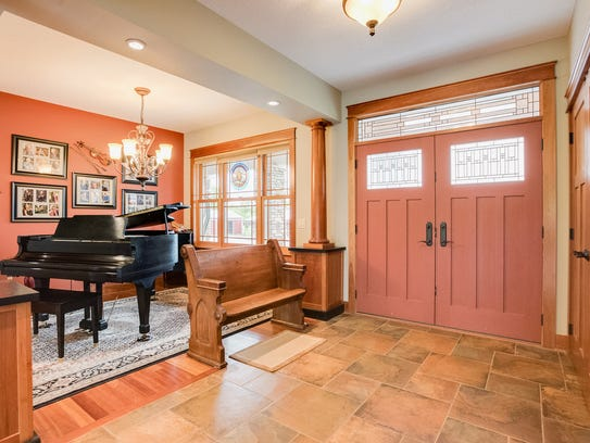 Double doors bring guests into the foyer at 22600 Meadowvale