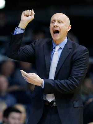 Xavier Musketeers head coach Chris Mack shouts to his offense in the first half of the NCAA Big East Conference basketball game between the Butler Bulldogs and the Xavier Musketeers at Hinkle Fieldhouse in Indianapolis on Tuesday, Feb. 6, 2018. Xavier led 40-30 at halftime.