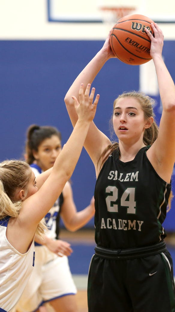 Salem Academy's Sydney Brown (24) looks to pass the