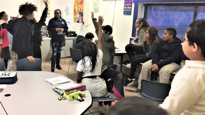 Marcquise Russell, a junior staff member at the Boys & Girls Club of Vineland, leads a prevention session at the club's Youth for Change Center.