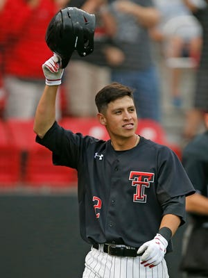 Texas Tech's Orlando Garcia (2) tips his helmet to the bullpen after hitting a home run against Delaware during an NCAA college baseball regional game friday, June 2, 2017, in Lubbock, Texas.