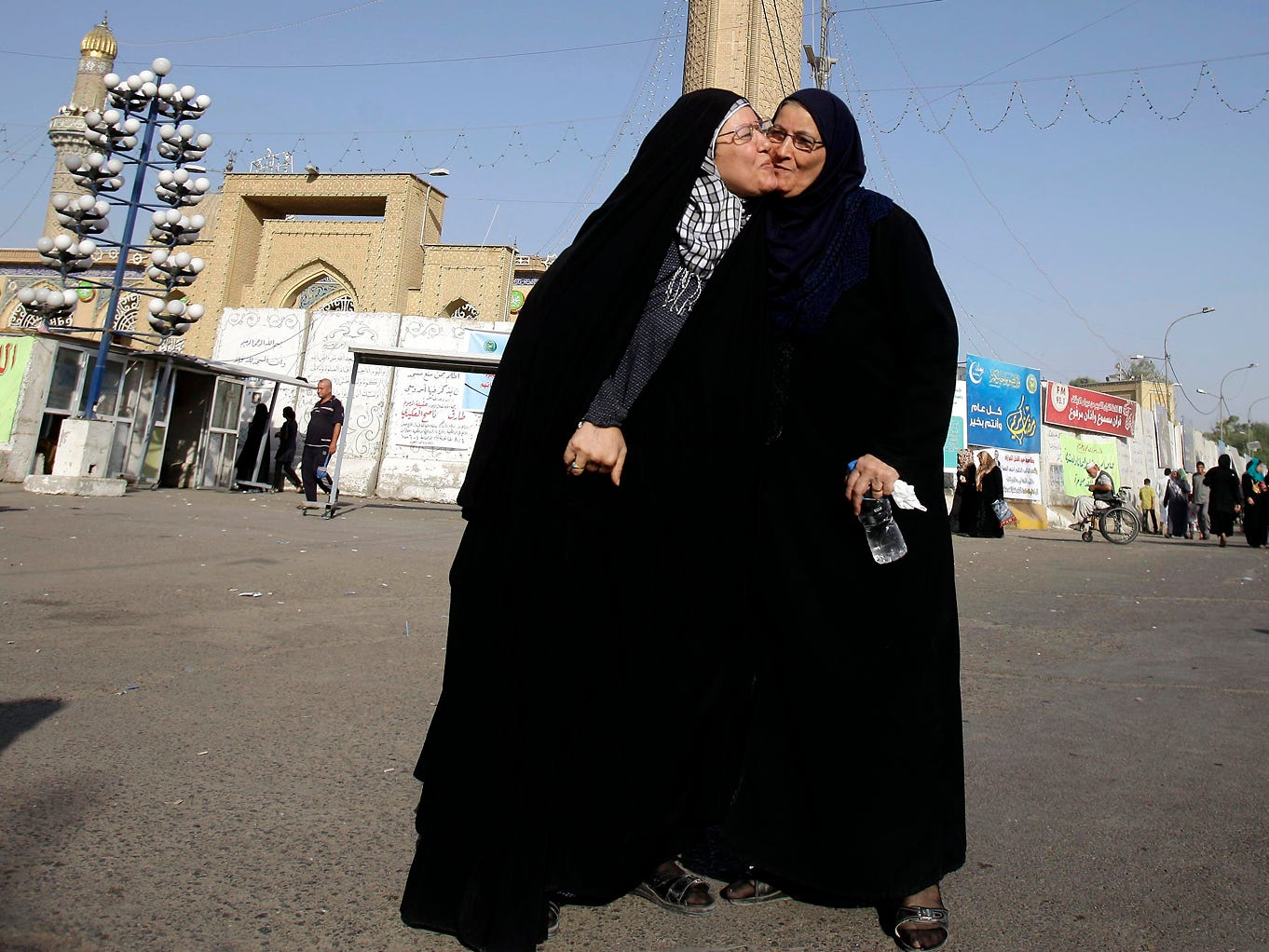 Women exchange greetings after dawn prayers outside the Abu Hanifa Mosque in Azamiyah, Iraq.