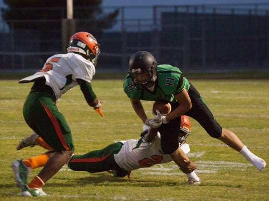 Virgin Valley's Timothy Moeai runs for yardage during the Bulldogs' Sept. 8 game against Mojave.
