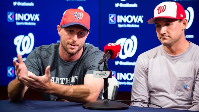 This file photo from July 3, 2017 shows Nationals starting pitcher Max Scherzer, left, and first baseman Ryan Zimmerman, right, speaking to the media at Nationals Park in Washington D.C. about their selection to the 2017 All-Star Game.