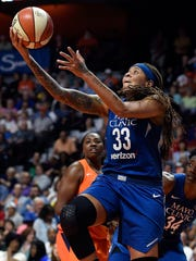 In this June 9, 2018, file photo, Minnesota Lynx guard Seimone Augustus drives to the basket against the Connecticut Sun during the first half of a WNBA basketball game at Mohegan Sun Arena in Uncasville, Conn. Augustus returned to the floor this week after knee surgery May 30.