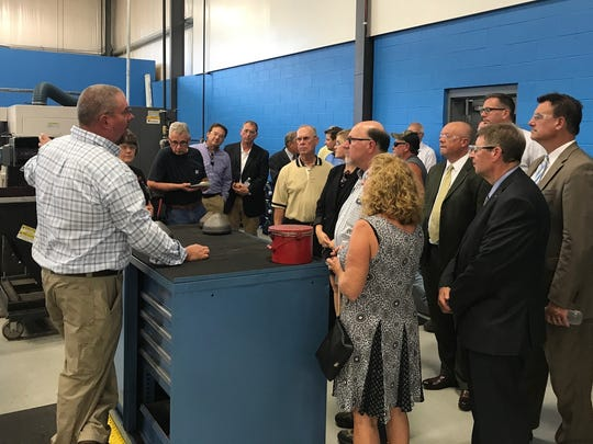 Visitors tour Atlas Copco on Sept. 26, 2017, during a ribbon cutting ceremony.