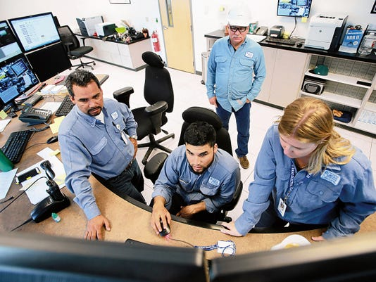 El Paso Electric Co. employees work Monday in the control room of the Montana Power Station. They are, from left, Superintendent Pete Flores, Jorge Martinez and Ashley Buster. Plant Manager Trehy Frisbie is in the background.