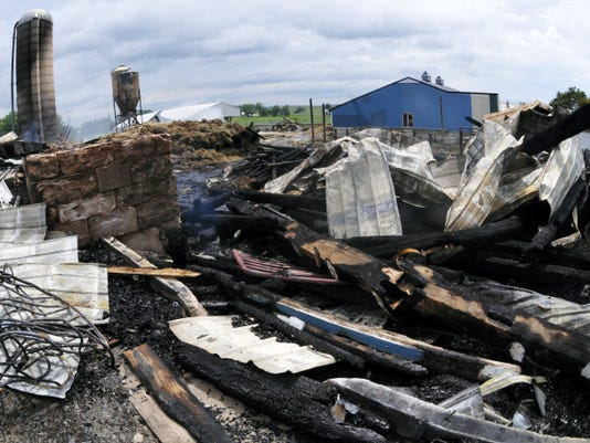 Several firefighters were treated for heat-related problems after fighting a barn fire Sunday evening next to the Cheese Haus at 8875 Edenville-Cheesetown Road, St. Thomas Township.