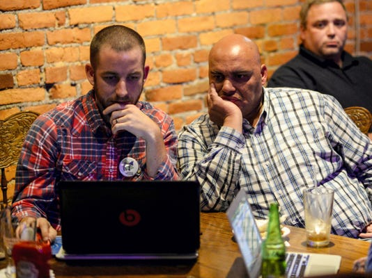 Joel Smith, left, and Democratic city council candidate Cornell Wilson watch results come in at the Downtown Lounge on Cumberland Street during the 2015 general election Tuesday. Based on initial vote totals, Wilson defeated Republican incumbent Councilwoman Pat Royer, but only by eight votes. Royer said she is waiting for the vote certification on Friday before conceding the race.