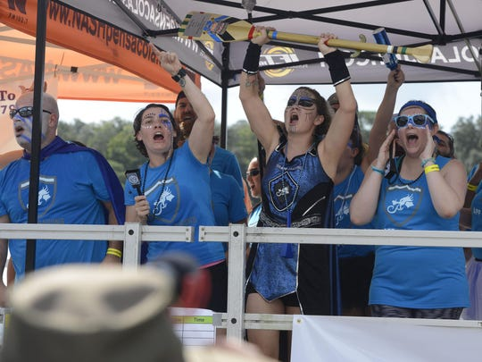 Having a support team to cheer on your favorite team is encouraged. AppRiver celebrates winning the Spirit Award during the third annual Pensacola Dragon Boat Race and Festival at Bayview Park.
