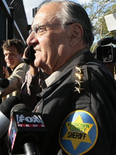 """Maricopa County Sheriff Joe Arpaio speaks to protesters after a press conference highlighting MCSO's most recent """"crime suppression operation"""" on April 29, 2010."""