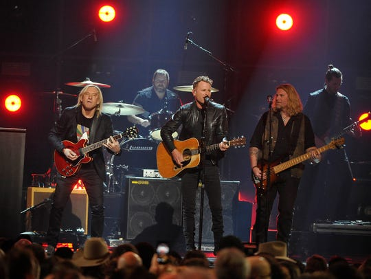 Joe Walsh, left, with Luke Bryan, center, perform during