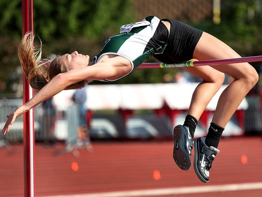 Zionsville's Katie Isenbarger takes a leap at the bar