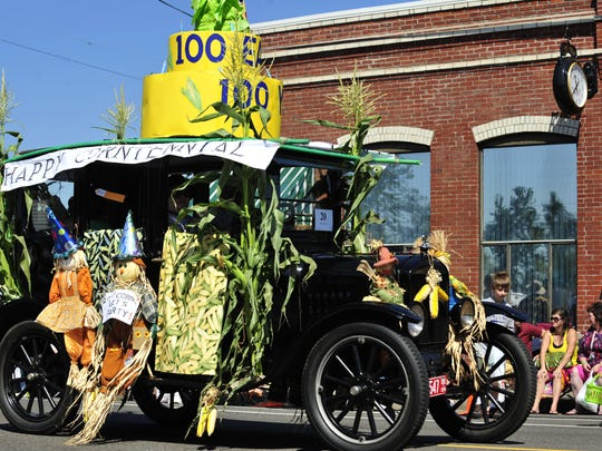 An entry in honor of AumsvilleÕs 100th birthday or ÒCorn-tennial,Ó the moniker for this yearÕs annual festival, is featured during the Aumsville Corn Festival parade Saturday, Aug. 27, 2011.
