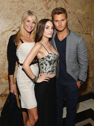 (L-R) Christie Brinkley, Alexa Ray Joel and Jack Brinkley-Cook  pose for a picture after Alexa performed during her stay at The Carlyle Hotel on June 26, 2014 in New York City.
