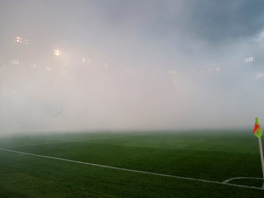 The stadium filled with smoke during the national championship soccer match between Spartak and CSKA in Moscow, Russia, on Saturday, Oct. 29, 2016. Crowd trouble marred a Moscow derby between arch-rivals Spartak and CSKA on Saturday, with the game briefly stopped as flares were thrown. The referee halted the match for five minutes in the second half as the stadium filled with smoke from flares and other pyrotechnics, some of which were thrown into sections packed with fans. (AP Photo/Ivan Sekretarev)