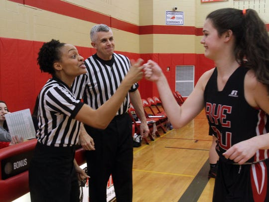 Referees Kim Saxton and Mark Farrell greet players before the start of the Somers vs Rye girls basketball game at Somers High School Feb. 23, 2017.
