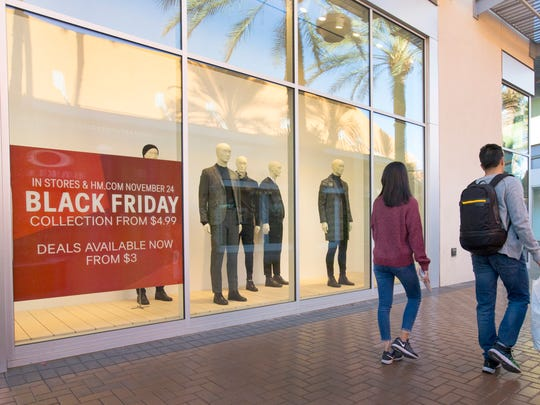 Shoppers look for deals at Tempe Marketplace during