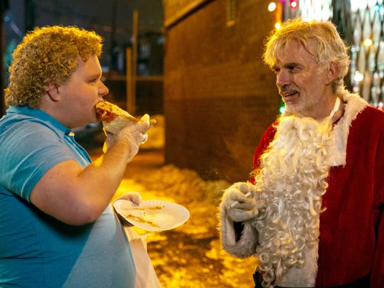 Brett Kelly (left) and Billy Bob Thornton in 'Bad Santa