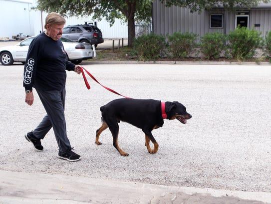 Denny Bales Takes His Dog Darius To Play At The