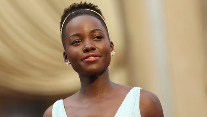 Lupita Nyong'o arrives at the Oscars at the Dolby Theatre in Los Angeles on March 2, 2014. Nyong'o is among the 271 people working in the movie business who have been asked to join its most exclusive club: the Academy of Motion Picture Arts and Sciences.