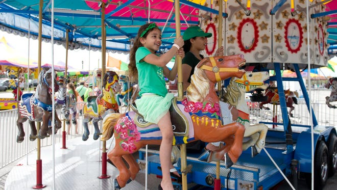 Port St. Lucie's St. Patrick's Day Festival Friday and Saturday features carnival rides.
