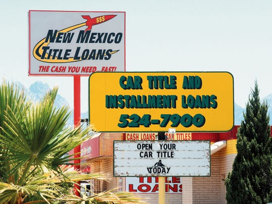 Robin Zielinski- Sun-News   Pictured are two storefront lenders located on East Lohman Avenue on Wednesday USA Title Loan, foreground, and New Mexico Title Loans.