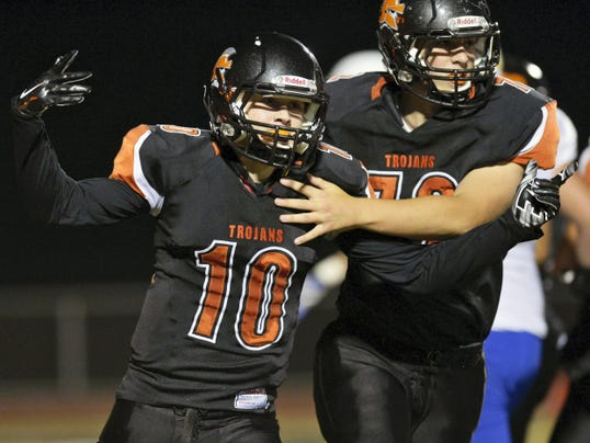 York Suburban's Collin Mailman celebrates a touchdown in the first half of a football game last season. Mailman is one of the top returning players in the YAIAA this season.