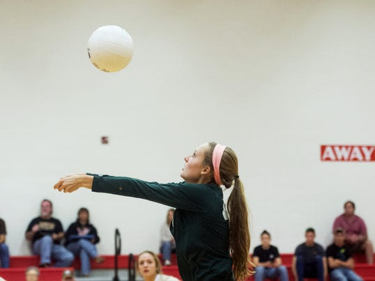 York Catholic's Brooke Ricks keeps her eye on the ball during a Division III match at Bermudian Springs on Monday.