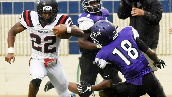 Parkway's Robert Mcknight escapes Lufkin's defense during the Battle on the Border Saturday at Independence Stadium.