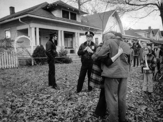 Diane Horton, friend of murder victim Robert Gierce, was hugged by a neighbor outside the murder scene at 1318 North LaSalle Street on Dec. 1, 1971.