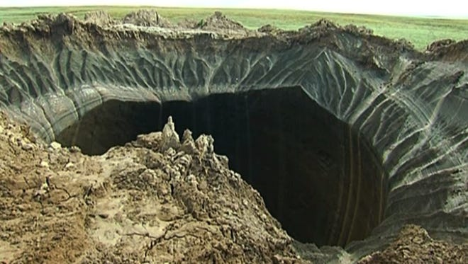 This frame grab made on July 16, 2014, shows a crater discovered recently in the Yamal Peninsula in Yamalo-Nenets Autonomous Okrug, Russia.