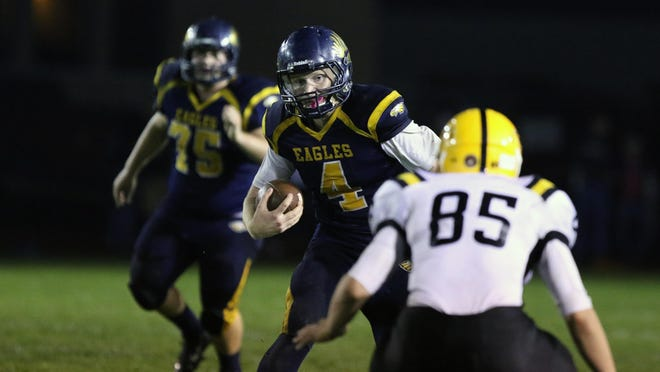 Stayton's Kyle Schwarm runs the ball as the Eagles fall to Cascade in an Oregon West Conference game Friday, Oct. 16, 2015, in Stayton.