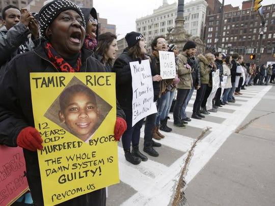 Demonstrators block Public Square in Cleveland on Tuesday during a protest over the weekend police shooting of Tamir Rice, 12. He was fatally shot by a Cleveland police officer after he reportedly pulled a replica gun at a city park.