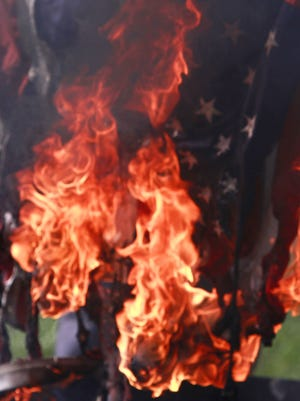 A flag is ceremonially retired in this file photo from a past Signal Fire weekend at AMVETS Post 12.