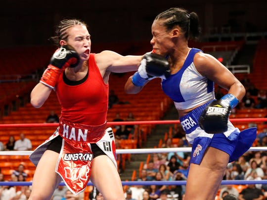 Fight action in the 10-round IBF World Featherweight title fight at the Don Haskins Center Saturday night featuring Jennifer Han and Liliana Martinez. Han retained her title after scoring a unanimous decision against Martinez.