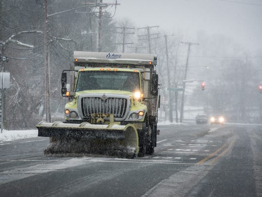 A plow pushes sleet on Route 35 in Eatontown around 5:30 p.m. Another nor'easter hit the Jersey Shore on Wednesday, March 21, 2018.