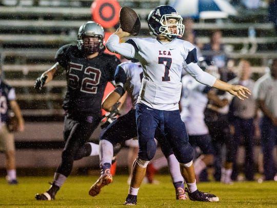 Lafayette Christian quarterback Zachary Clement (7) attempts a pass during an LHSAA football game at Vermilion Catholic High School in Abbeville, La., Friday, Nov. 6, 2015.