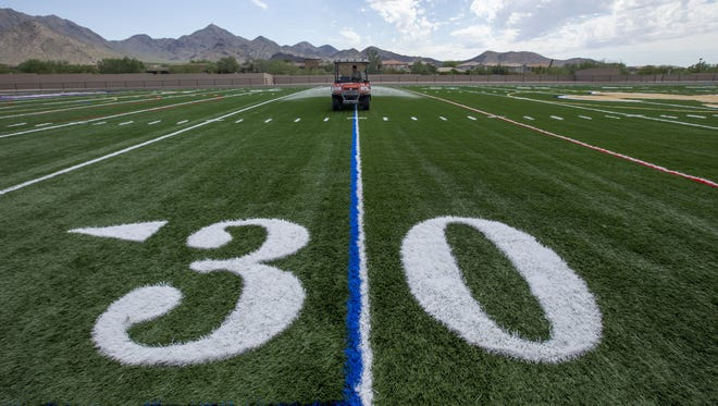 Final preparations are being made throughout the state for the 2014 Arizona high school football season. At Scottsdale Notre Dame Prep, work continues on a new football field.