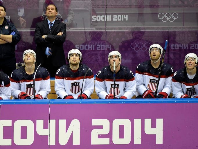USA players look up at the video board after a goal by Canada forward Jamie Benn.