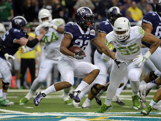 Jan 2, 2016; San Antonio, TX, USA; TCU Horned Frogs running back Aaron Green (22) is pursued by Oregon Ducks defensive lineman Tui Talia (55) during the 2016 Alamo Bowl at Alamodome. Mandatory Credit: Kirby Lee-USA TODAY Sports