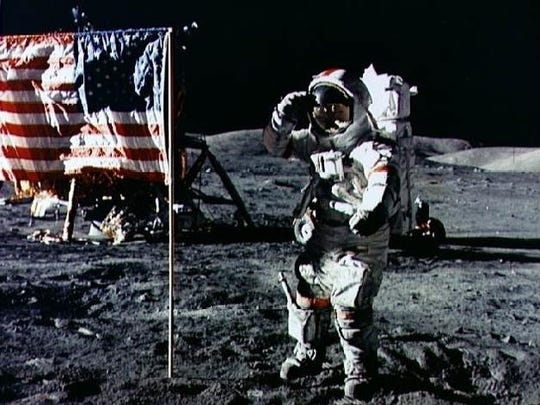 Aldrin salutes the flag he just planted on the Moon.