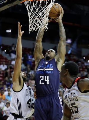 Dallas Mavericks' Chane Behanan goes up for a dunk against Chicago Bulls' Denzel Valentine during the second half of an NBA summer league basketball game Thursday, July 14, 2016, in Las Vegas. (AP Photo/John Locher)